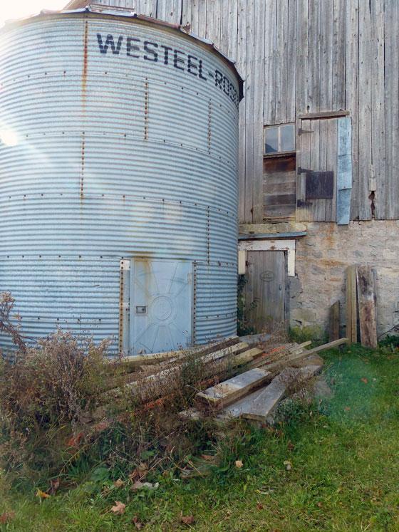Lumber piled outside the barn