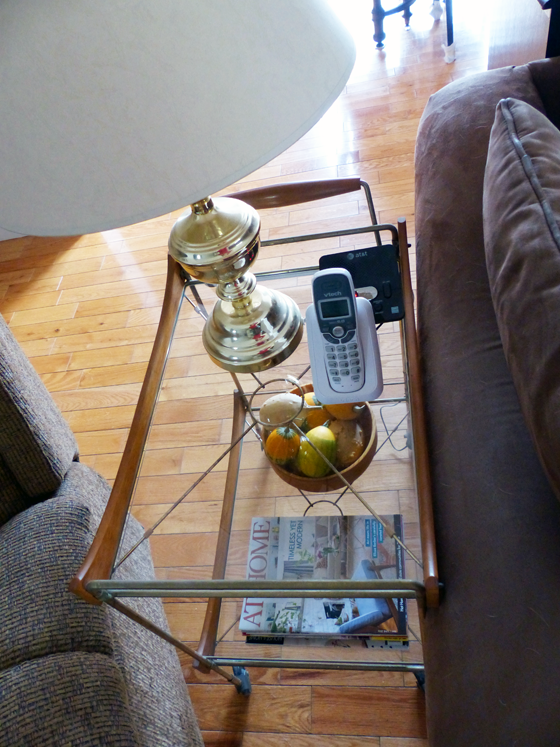 Vintage bar cart used as an end table in the living room