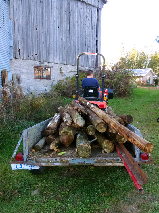 Trailer loaded with old fence posts