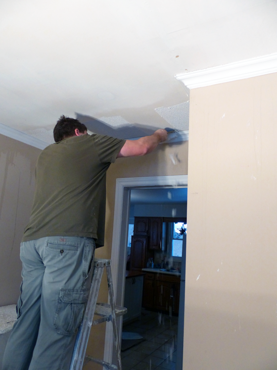Matt scraping the stippled ceiling
