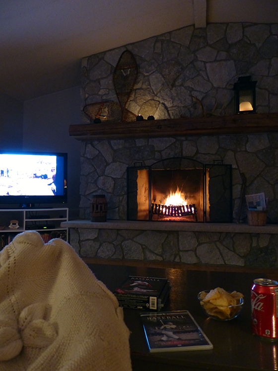 Cozy night in the living room in front of the fireplace