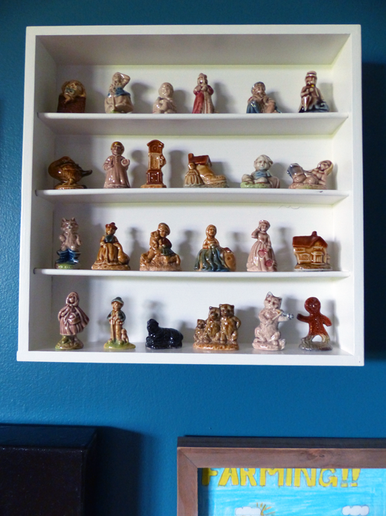 Red Rose Tea figurines displayed on a cutlery tray made into a shelf