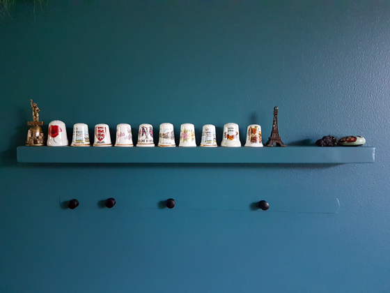 China thimbles displayed on a small floating shelf