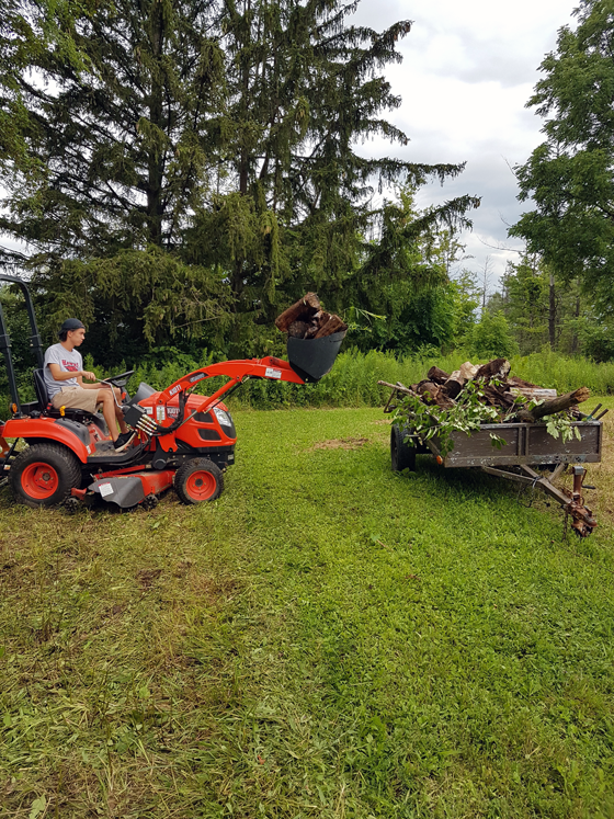 Loading firewood with the front end loader