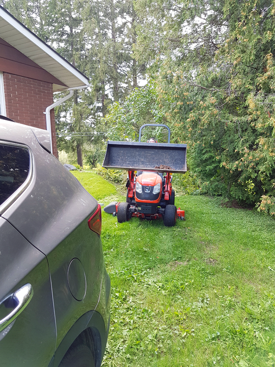 Tractor behind the car