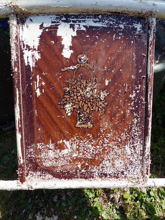 Faux wood grain paint on a metal bedframe