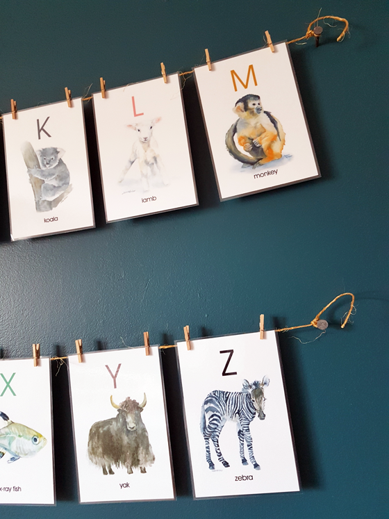 Alphabet flashcards hung on a twine clothesline