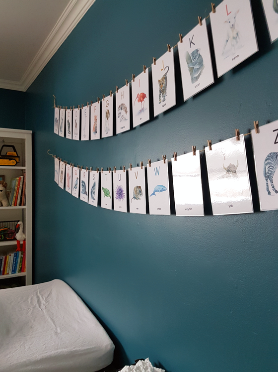 Alphabet flashcards above the changing table