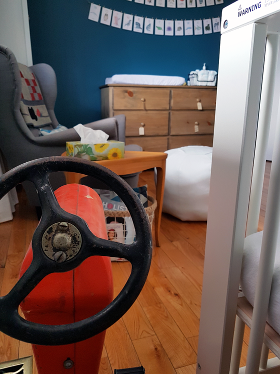 Vintage pedal car tractor in the nursery