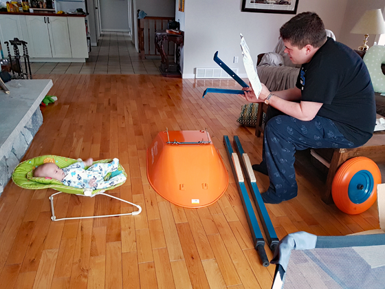 Matt and Ellie assembling the wheelbarrow