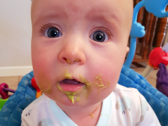 Ellie eating food for the first time