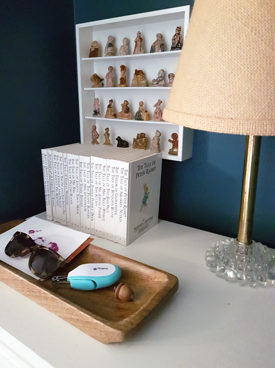 Wood tray on a white dresser