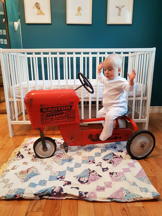 Ellie sitting on her tractor