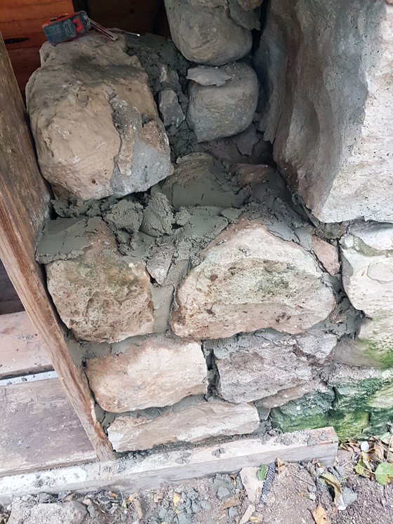 Repairing a stone barn foundation