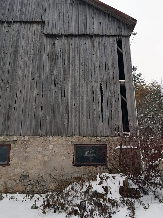 Patching wood siding on a barn