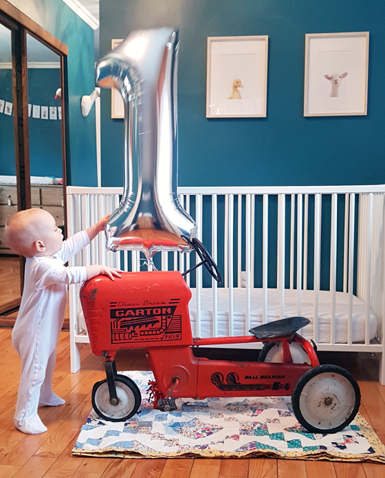 Baby with tractor pedal car