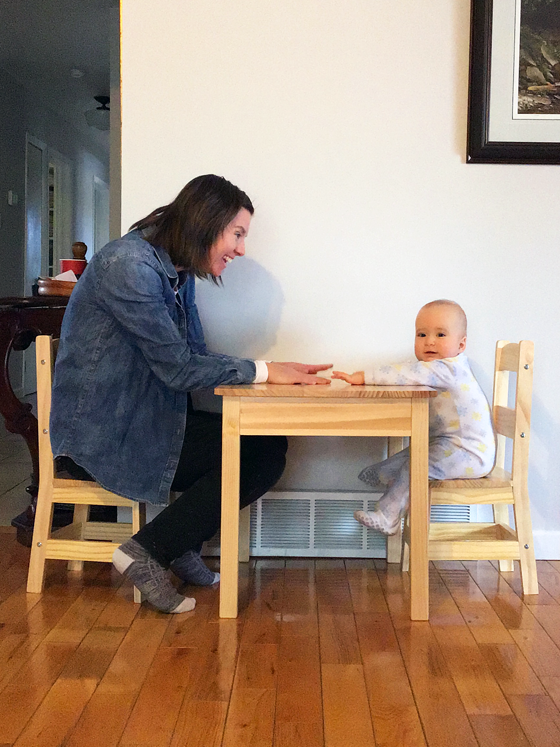Mom and baby sitting a child size table