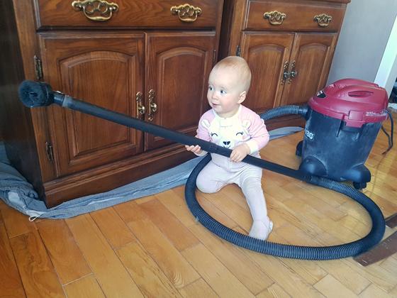 Ellie vacuuming in the dining room