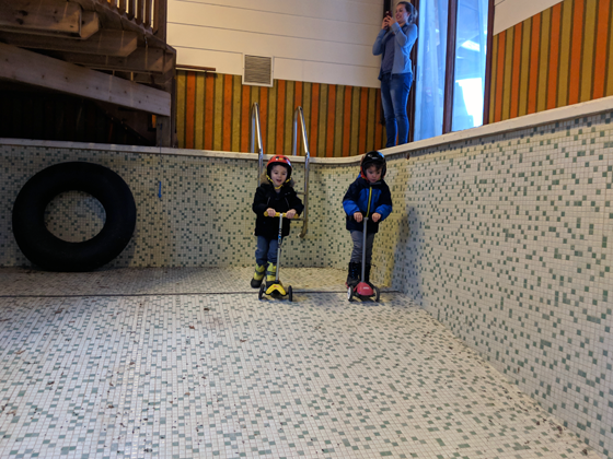 Riding scooters in the indoor pool