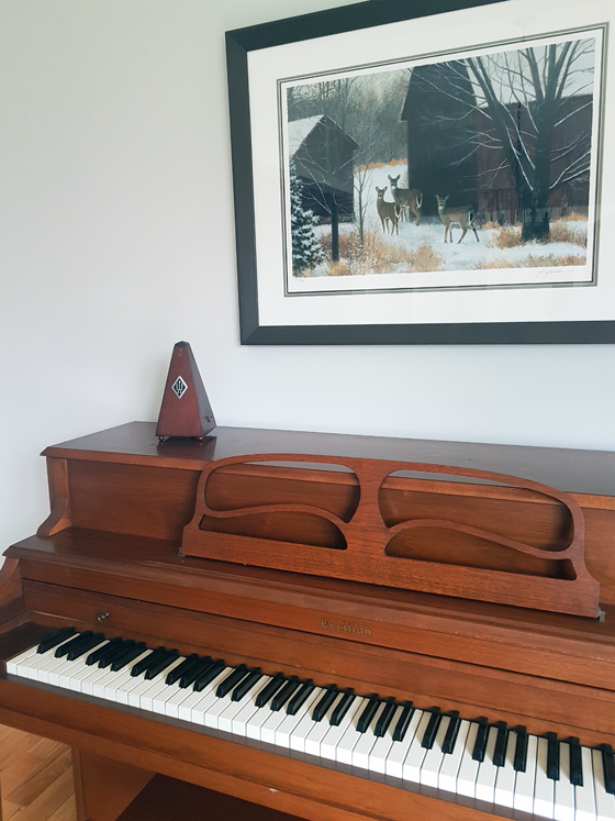 Deer painting above a piano