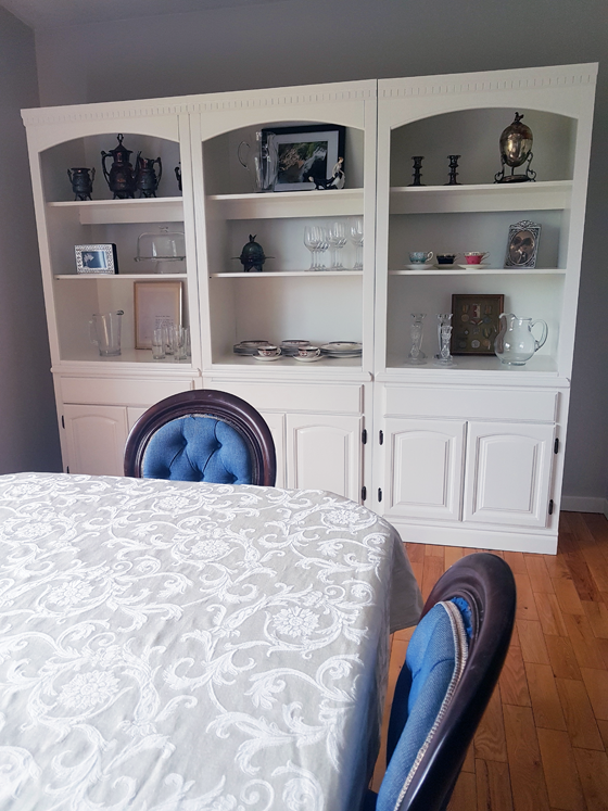 White china cabinet in the dining room