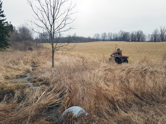Surveying the field by ATV to prepare for tiling