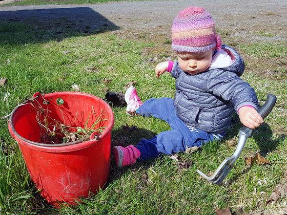 Ellie gardening at 1 year old