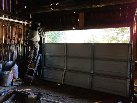 Installing a new garage door on the small barn