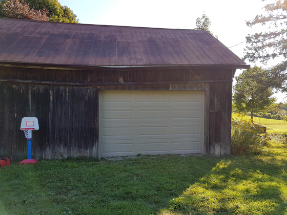 New garage door on the small barn