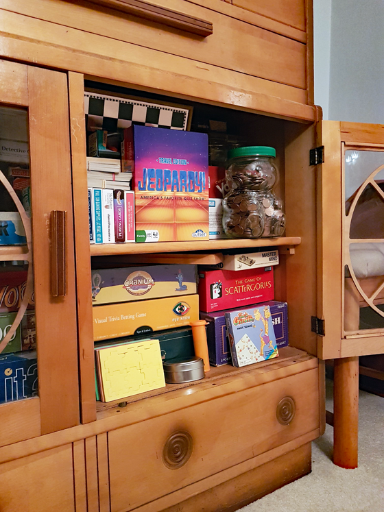 Boardgame storage in a vintage china cabinet