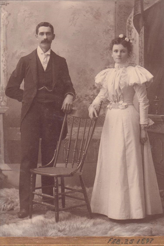 Black and white photo of a man and woman on their wedding day in 1897