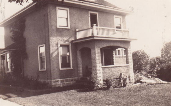 Black and white picture of a two story farmhouse