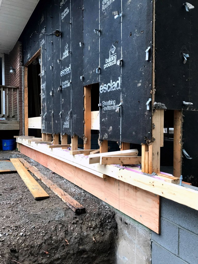 Pouring footings under existing wall